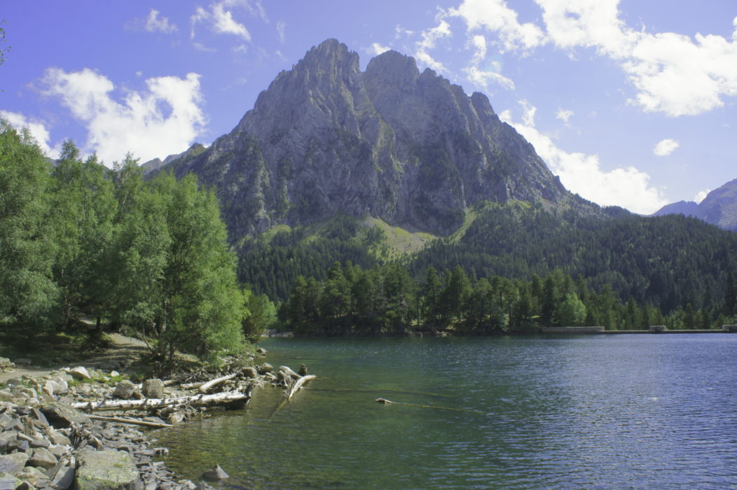 The Encantats peaks rise above the Sant Maurici lake