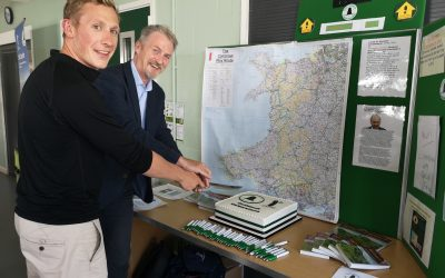 Huw Irranca-Davies and Will Renwick cut the cake at the Cambrian Way book launch
