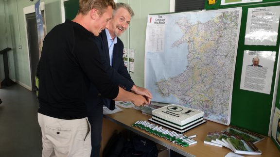 Huw Irranca-Davies and Will Renwick cut the cake at the Cambrian Way launch