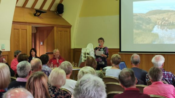 Audrey welcoming everyone to the launch, shortly before receiving a signed copy of the book