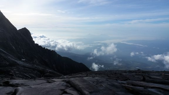 Amazing views of Kota Belud town from the descent down naked scoured granite. Hold on tight to the rope!