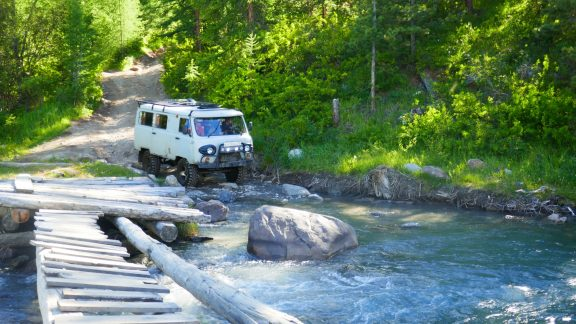 02 Sturdy Uaz Furgon vehicles are used on a rough track to reach the Blue lake trailhead