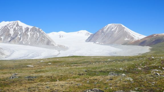 08 Mt Malchin right rises above the Potanii glacier with permanently snow capped Mt Khuiten Uul in the far background