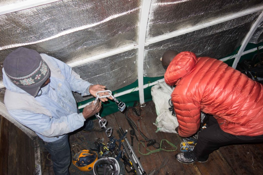 The guides sorting out the mountaineering equipment
