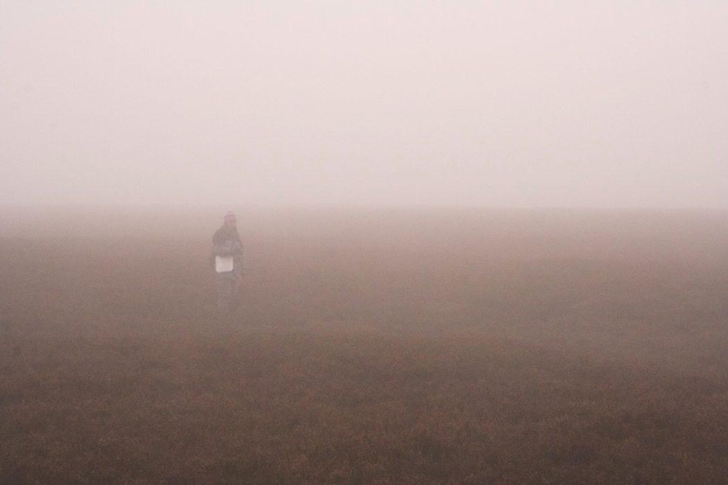 Walker in mist
