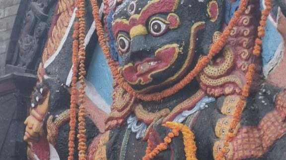 A religious icon decorated with marigold garlands for the festival