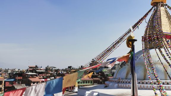 Prayer flags draped from a stupa