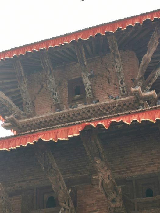 Cracks in the temple buildings. Health and safety doesn't seem to be much of a concern in Nepal and people were enjoying their lunch on the steps underneath this building.