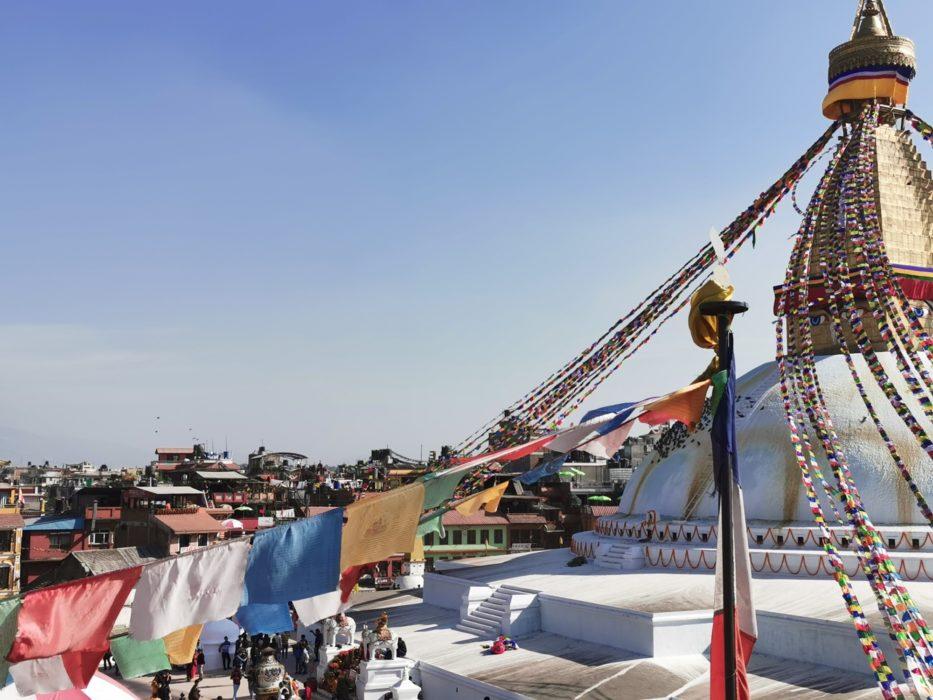 Prayer flags draped from a stupa