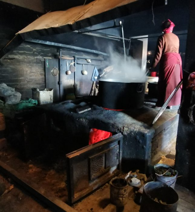 We were invited into the monastery's kitchen for a cup of salt butter tea. Cooking dhal bat for the residents requires a massive pan!