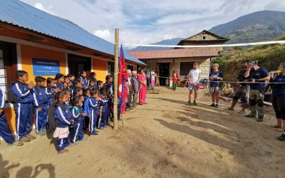 A group photo in front of the finished school