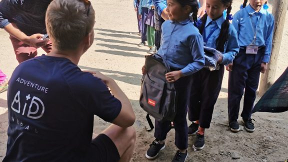 Handing out uniforms