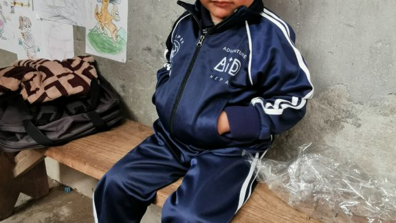 One of the children at Kinja wearing their new uniform