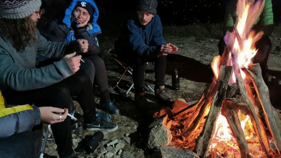 Sitting around the campfire in the evenings