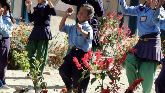 The group of children leading the dance