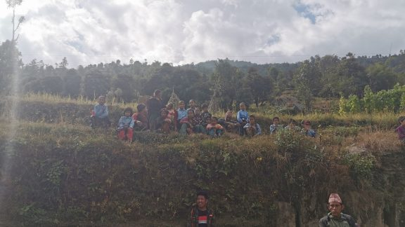 The schoolchildren at Rawa Dolu watching us work from their temporary classroom
