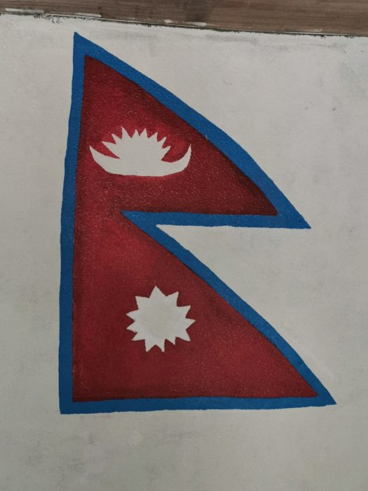 A finished painting of the Nepal flag