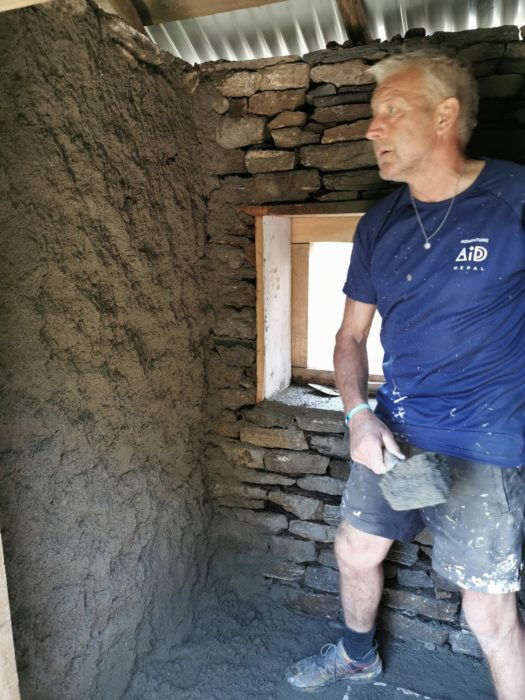 David plastering the walls of the toilet block