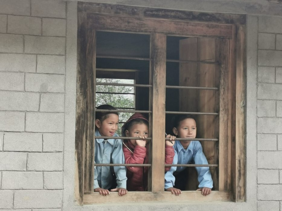 Peeking at us from inside the classrooms before we started work