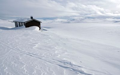 The DNT hut against a brilliant winter background