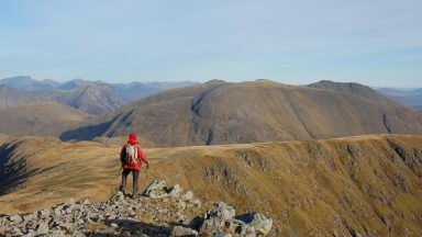 A mountain, a ridgeline, and a man in a red jacket – 'unoriginal and lacking spark' but just right for a guidebook. Stob Ghabhar