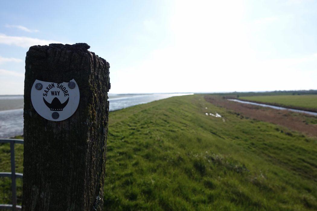 11 Saxon Shore Way marker and sea wall
