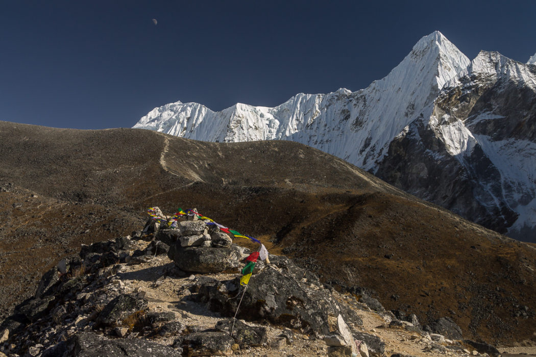 Prayer Flags At The Top Of A Moraine Above  Ama  Dablam Base Camp At Around 5000M The Scenery Is Dominated By  Malanphulan 6573M And Its Impressive North Face