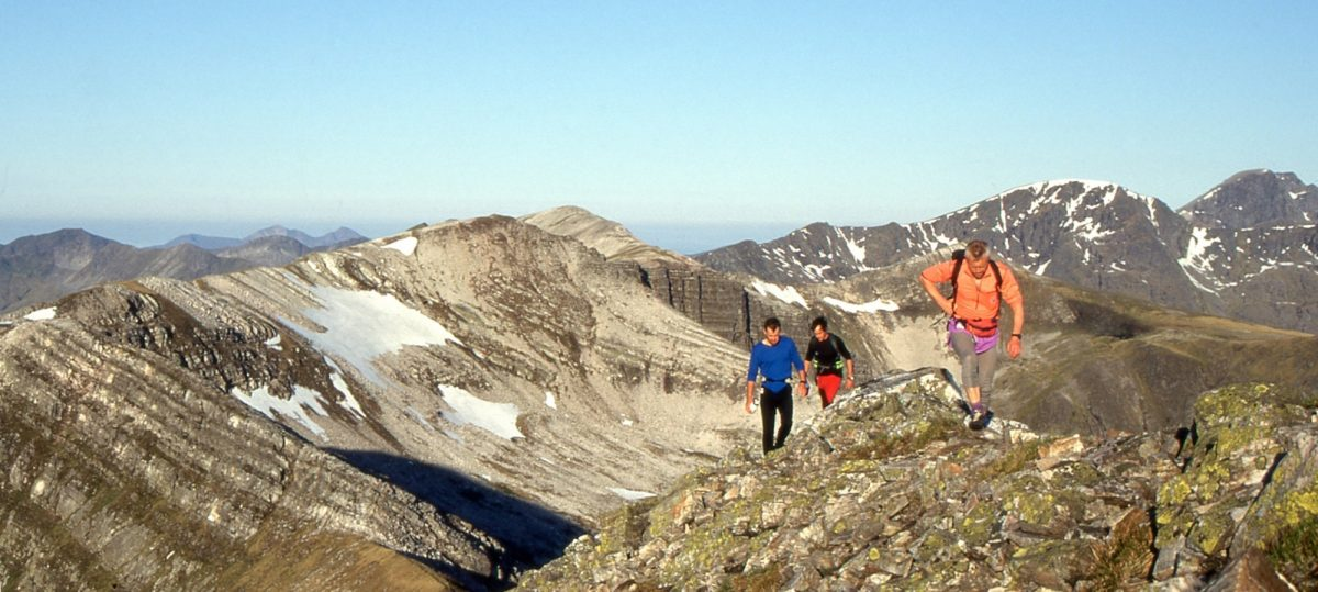 A Ramsays Round Runner And His Supporters On The Grey Corries