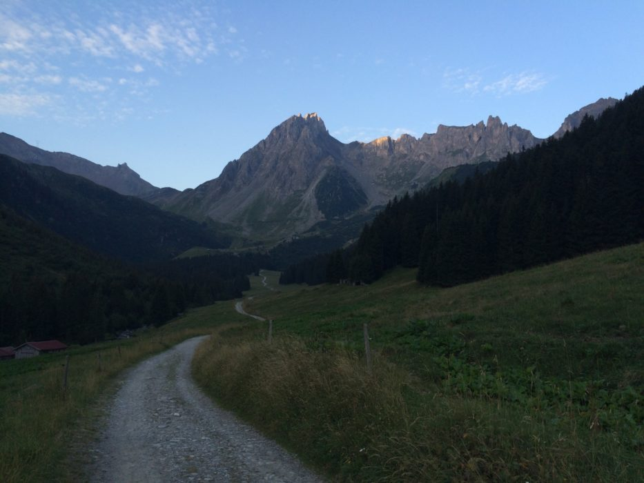 The Long Trail Ahead And The Sun Just Barely Clipping The High Ridges