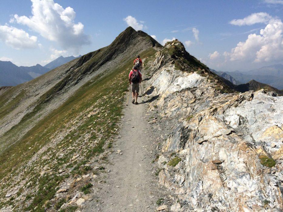Hikers Crossing The Ridge Easily