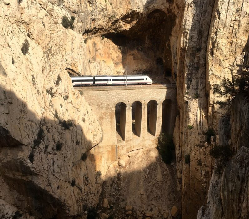 A Train En Route To  Malaga Emerges Briefly From The Mountain