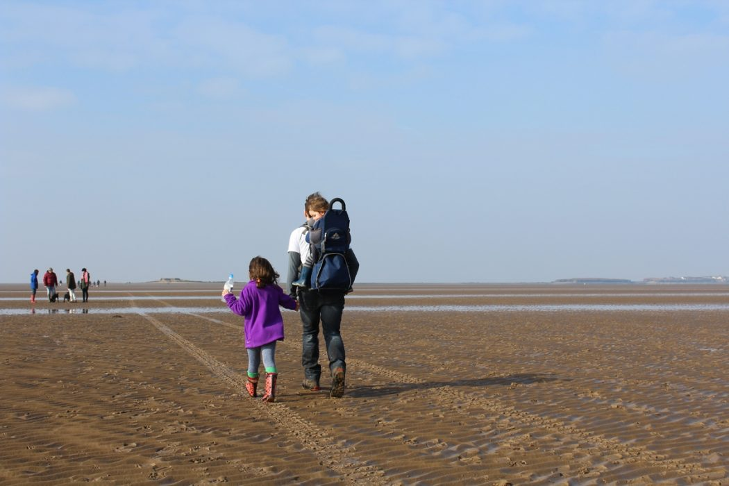children walking to Hillbre island