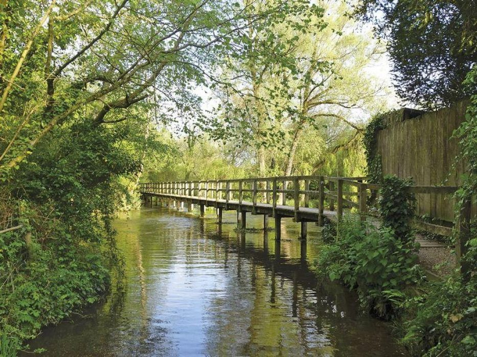 The Test Way offers beautiful scenery and less difficult walking. The long bridge at Wherwell, Test Way