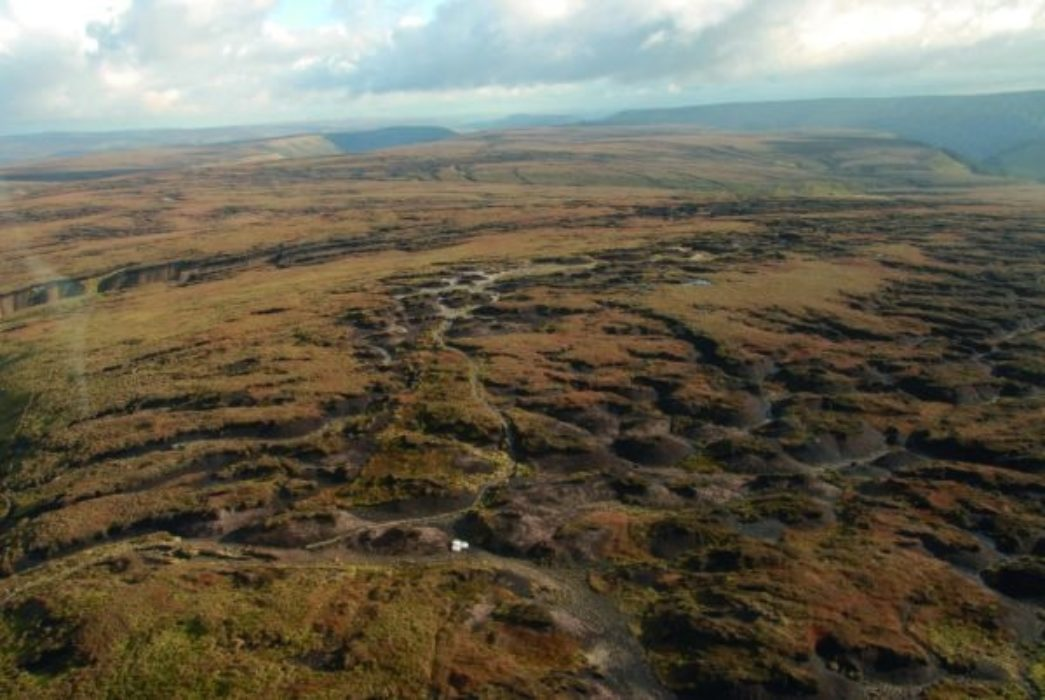 The eroded top of Bleaklow, with the Pennine Way running across the middle. (photo: Moors for the Future Partnership)