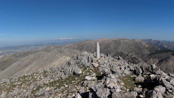 The distant snow-capped Sierra Nevada from the summit of Malascamas