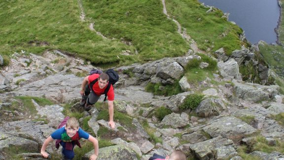 children scrambling Carnedd Llwellyn Wales
