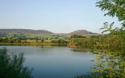 Tittesworth Reservoir with the Roaches behind in late afternoon sunlight