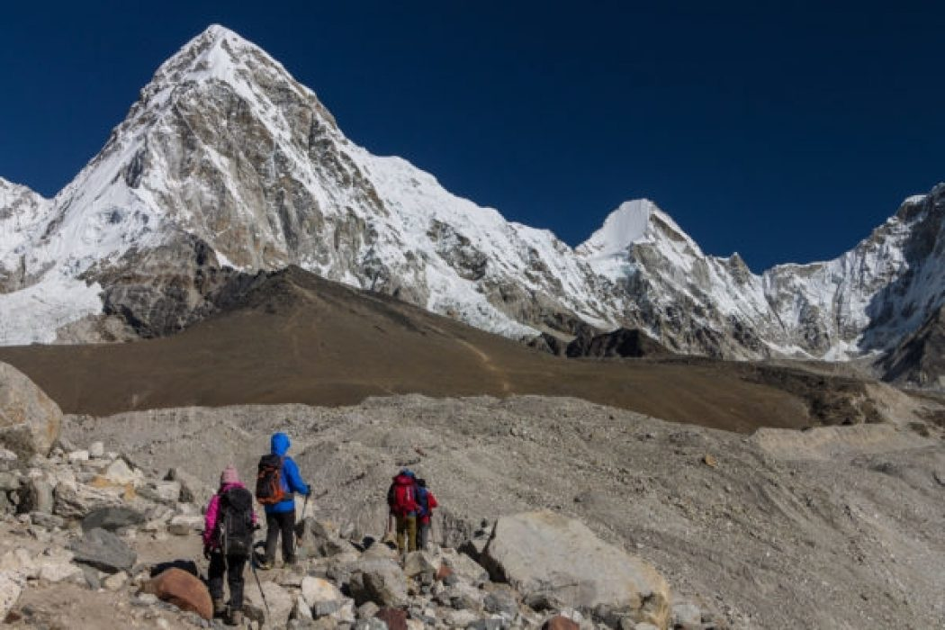 Trekkers Approaching Gorakshep In The Khumbu Valley  Pumori 7161M Is On The Left And Kala Patthar Peak C 5640M Which Is One Of The Best View Points In The Everest Region Is Below It  Everest Base Camp Trek Nepal