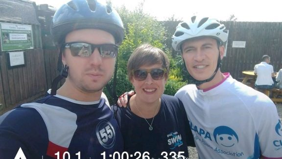 Me and my two friends on one of our two training rides. We're at the ice-cream parlour.